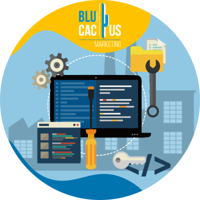 BluCactus - ¿Qué es una Empresa de Desarrollo de Software? - computadora con herramientas al rededor